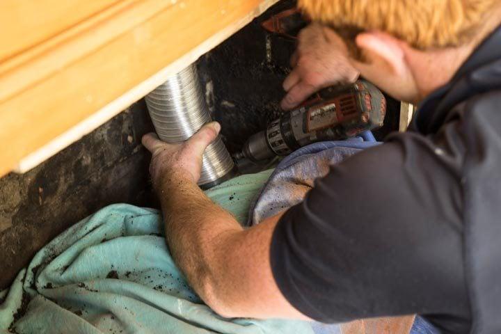 Worker installing flue