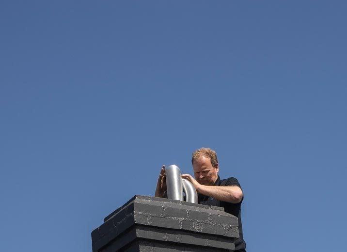Installing flue down chimney